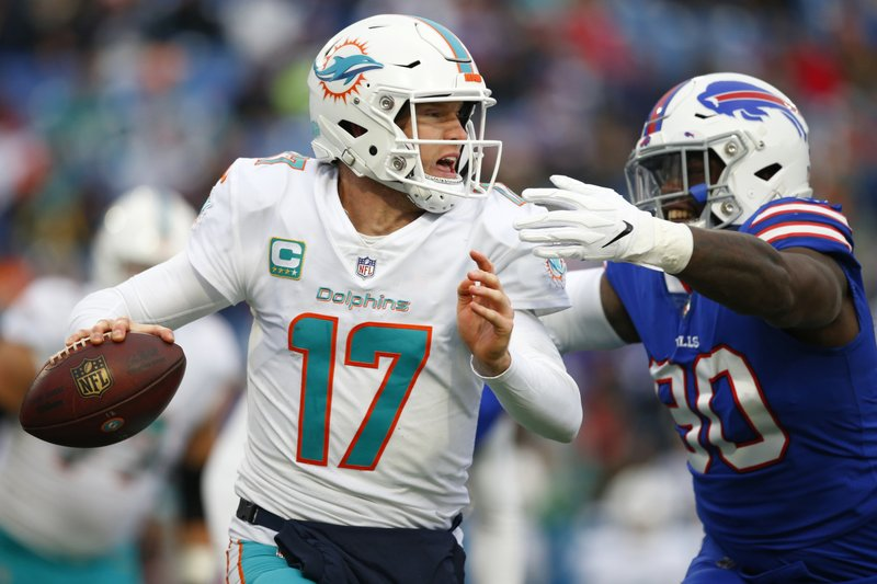 Buffalo Bills defensive end Shaq Lawson (90) puts pressure on Miami Dolphins quarterback Ryan Tannehill (17) during the second half of an NFL football game, Sunday, Dec. (AP Photo/Jeffrey T. Barnes)