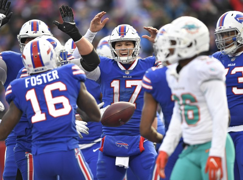 Buffalo Bills quarterback Josh Allen (17) celebrates after running back LeSean McCoy scored a 5-yard touchdown during the second half of an NFL football game against the Miami Dolphins, Sunday, Dec. (AP Photo/Adrian Kraus)