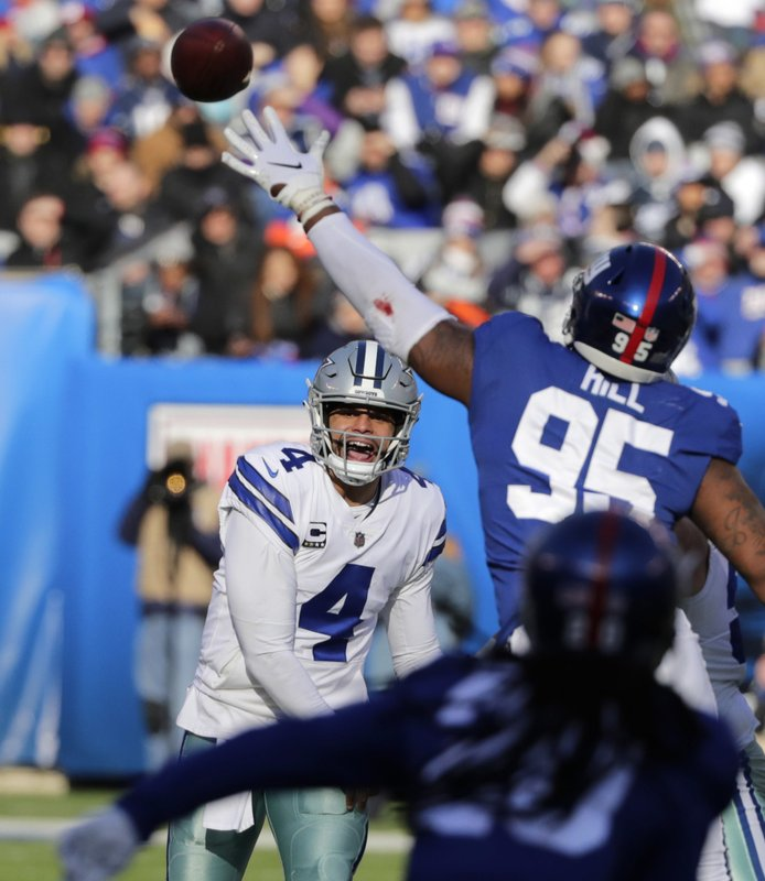 Dallas Cowboys quarterback Dak Prescott, left, throws during the first half of an NFL football game against the New York Giants, Sunday, Dec. (AP Photo/Frank Franklin II)