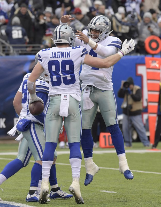 Dallas Cowboys quarterback Dak Prescott, right, celebrates with Blake Jarwin (89) after scoring a touchdown during the first half of an NFL football game against the New York Giants, Sunday, Dec. (AP Photo/Bill Kostroun)