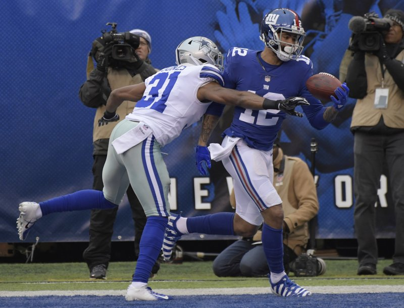 New York Giants' Cody Latimer, right, catches a touchdown during the first half of an NFL football game against the Dallas Cowboys, Sunday, Dec. (AP Photo/Bill Kostroun)