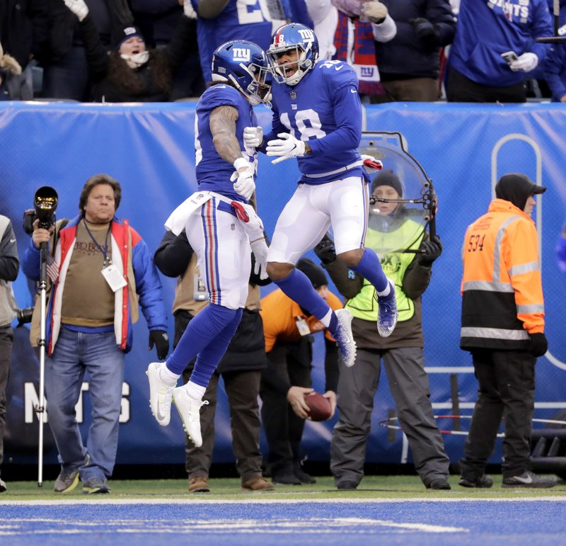 New York Giants' Evan Engram, left, celebrates his touchdown with Bennie Fowler during the second half of an NFL football game against the Dallas Cowboys, Sunday, Dec. (AP Photo/Frank Franklin II)