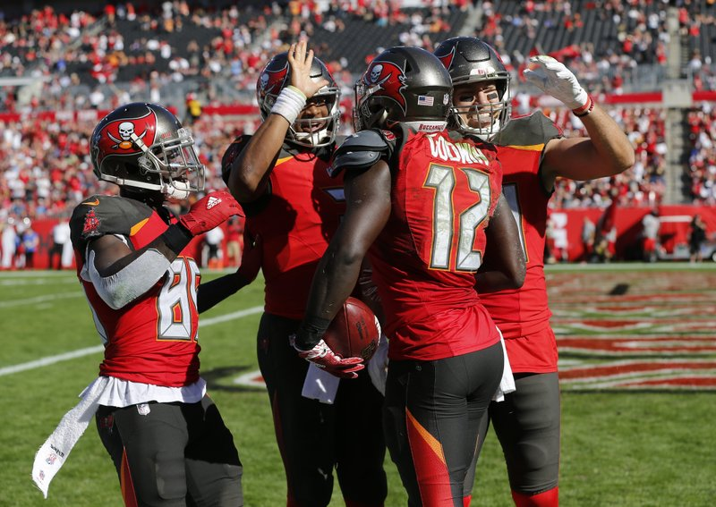 Tampa Bay Buccaneers wide receiver Chris Godwin (12) celebrates his touchdown against the Atlanta Falcons with wide receiver Bobo Wilson (85), Tampa Bay Buccaneers quarterback Jameis Winston (3) and wide receiver Mike Evans (13) during the first half of an NFL football game Sunday, Dec. (AP Photo/Mark LoMoglio)