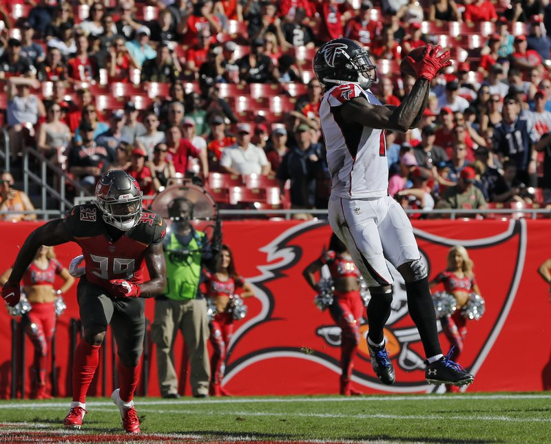 Atlanta Falcons wide receiver Julio Jones (11) pulls in a 19-yard touchdown pass in front of Tampa Bay Buccaneers free safety Isaiah Johnson (39) during the first half of an NFL football game Sunday, Dec. (AP Photo/Mark LoMoglio)