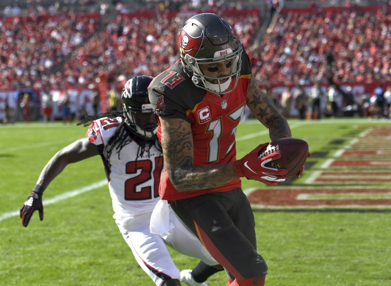 Tampa Bay Buccaneers wide receiver Mike Evans (13) beats Atlanta Falcons cornerback Desmond Trufant (21) on a 19-yard touchdown reception during the first half of an NFL football game Sunday, Dec. (AP Photo/Jason Behnken)