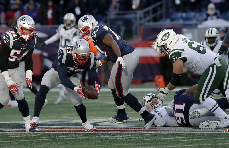 New England Patriots linebacker Kyle Van Noy picks up a fumble by New York Jets quarterback Sam Darnold, on the turf at right, before running to the end zone for a touchdown during the second half of an NFL football game, Sunday, Dec. (AP Photo/Charles Krupa)