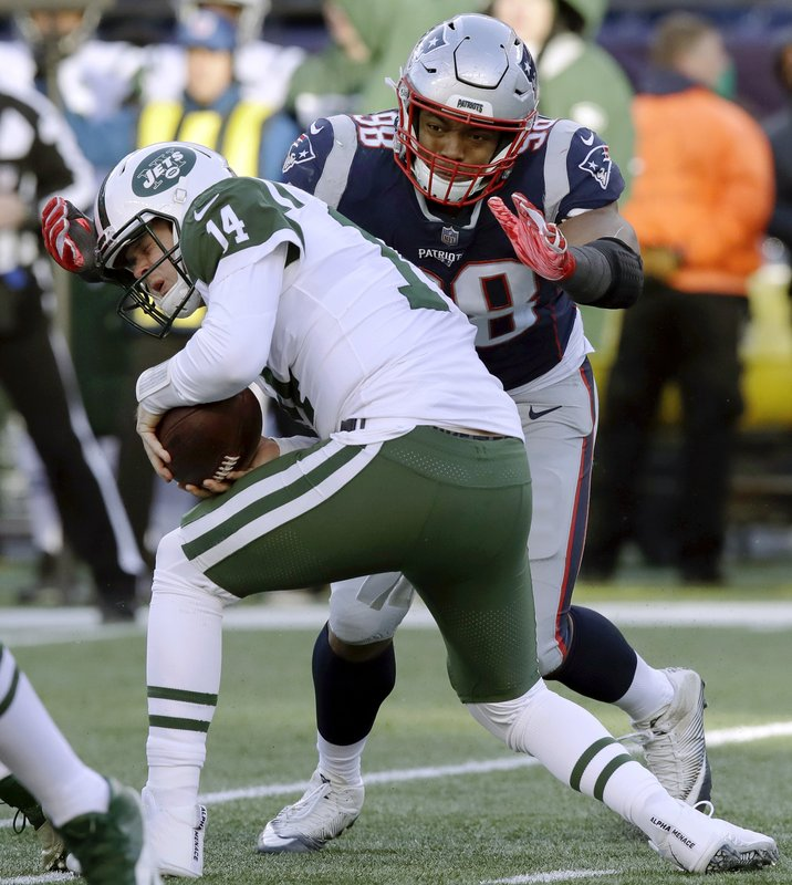 New England Patriots defensive end Trey Flowers, rear, sacks New York Jets quarterback Sam Darnold during the second half of an NFL football game, Sunday, Dec. (AP Photo/Charles Krupa)