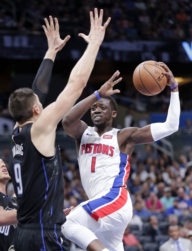 Detroit Pistons' Reggie Jackson (1) makes a move to get to the basket against Orlando Magic's Nikola Vucevic (9) during the first half of an NBA basketball game, Sunday, Dec. (AP Photo/John Raoux)