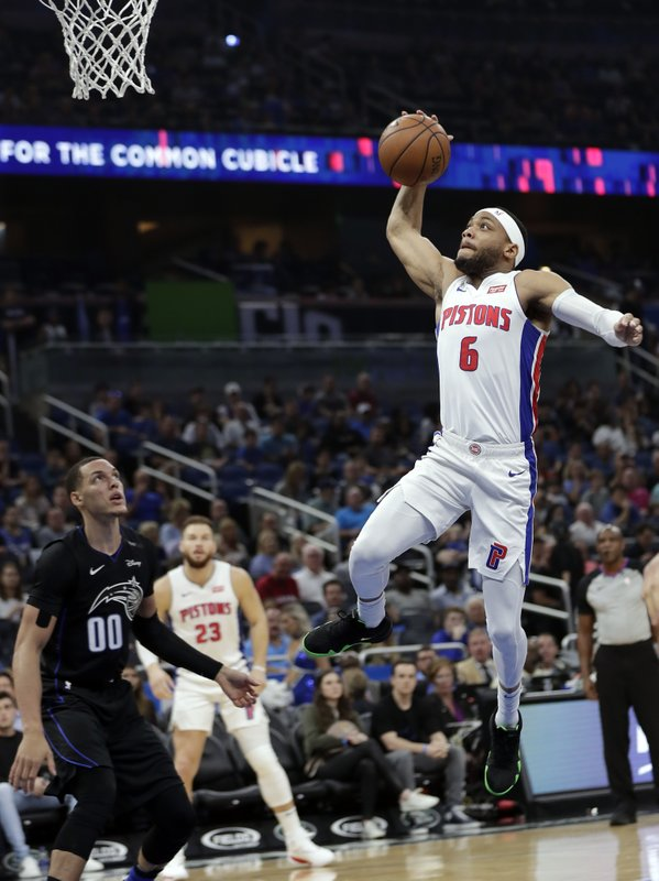 Detroit Pistons' Bruce Brown (6) goes up for a shot over Orlando Magic's Aaron Gordon (00) during the first half of an NBA basketball game, Sunday, Dec. (AP Photo/John Raoux)