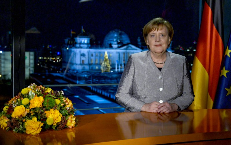 German Chancellor Angela Merkel poses for a photograph after the recording of her annual New Year's speech at the Chancellery in Berlin, Germany, Dec. (John MacDougall/pool photo via AP)