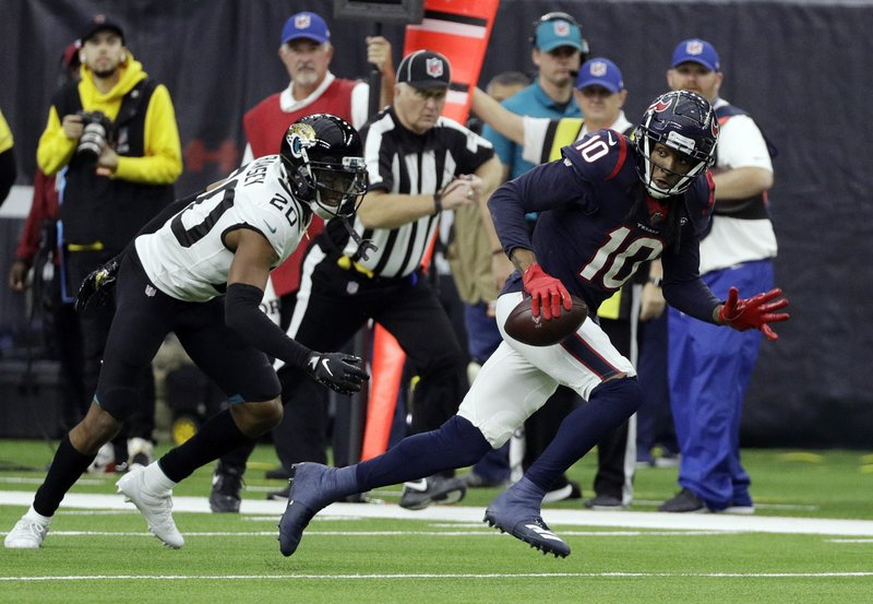 Houston Texans wide receiver DeAndre Hopkins (10) runs past Jacksonville Jaguars cornerback Jalen Ramsey (20) after making a catch during the second half of an NFL football game, Sunday, Dec. (AP Photo/David J. Phillip)