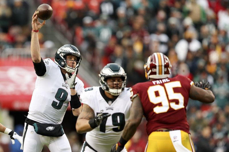 Philadelphia Eagles quarterback Nick Foles (9) passes the ball during the first half of an NFL football game against the Washington Redskins, Sunday, Dec. (AP Photo/Andrew Harnik)