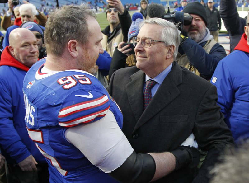 Miami Dolphins owner Stephen M. Ross talks with defensive tackle Kyle Williams speak after an NFL football game against the Miami Dolphins, Sunday, Dec. (AP Photo/Jeffrey T. Barnes)