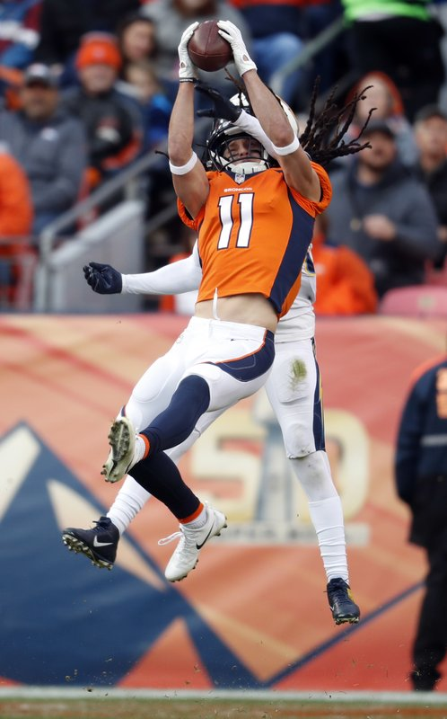 Denver Broncos wide receiver River Cracraft hauls in a pass as Los Angeles Chargers strong safety Jahleel Addae defends during the first half of an NFL football game, Sunday, Dec. (AP Photo/David Zalubowski)