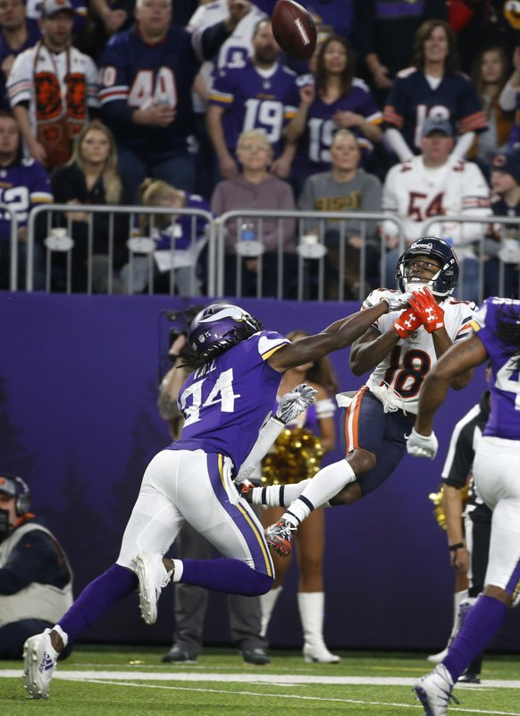 Chicago Bears wide receiver Taylor Gabriel (18) catches a pass over Minnesota Vikings defensive back Holton Hill (24) during the first half of an NFL football game, Sunday, Dec. (AP Photo/Bruce Kluckhohn)