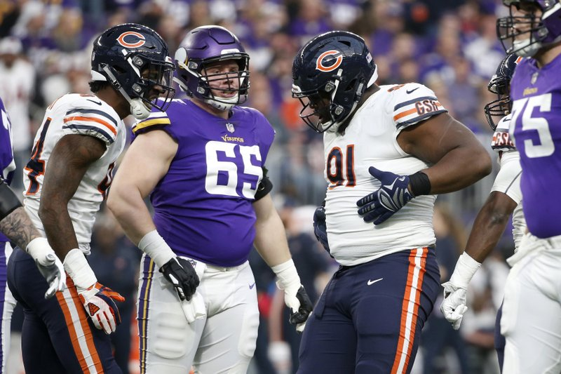 Chicago Bears nose tackle Eddie Goldman (91) celebrates in front of Minnesota Vikings center Pat Elflein (65) after a sack during the first half of an NFL football game, Sunday, Dec. (AP Photo/Bruce Kluckhohn)