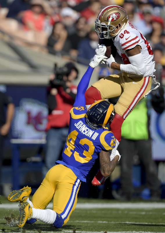 San Francisco 49ers wide receiver Kendrick Bourne, top, catches a pass over Los Angeles Rams strong safety John Johnson during the first half in an NFL football game Sunday, Dec. (AP Photo/Mark J. Terrill)