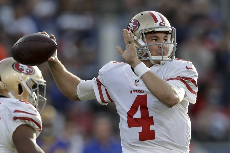 San Francisco 49ers quarterback Nick Mullens passes against the Los Angeles Rams during the second half in an NFL football game Sunday, Dec. (AP Photo/Marcio Jose Sanchez)
