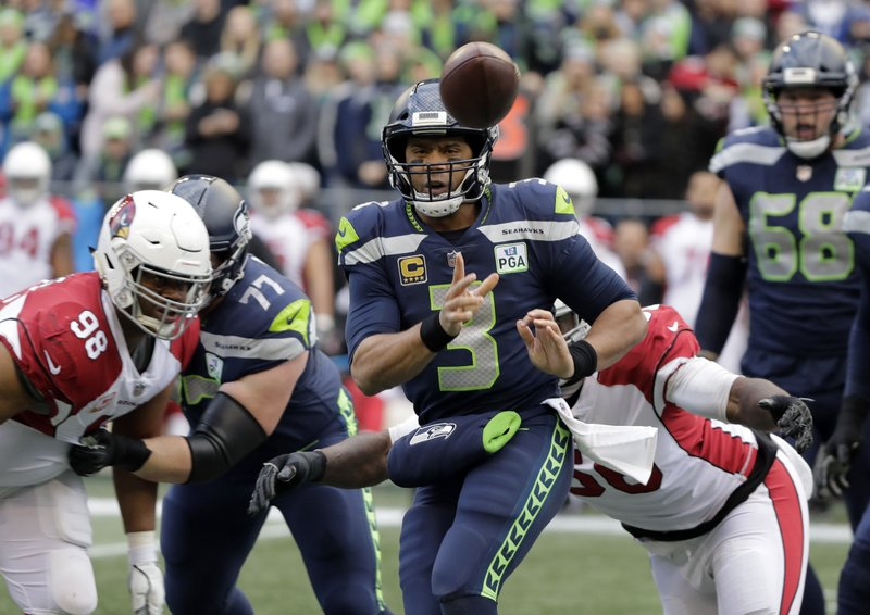 Seattle Seahawks quarterback Russell Wilson (3) passes against the Arizona Cardinals during the first half of an NFL football game, Sunday, Dec. (AP Photo/Ted S. Warren)