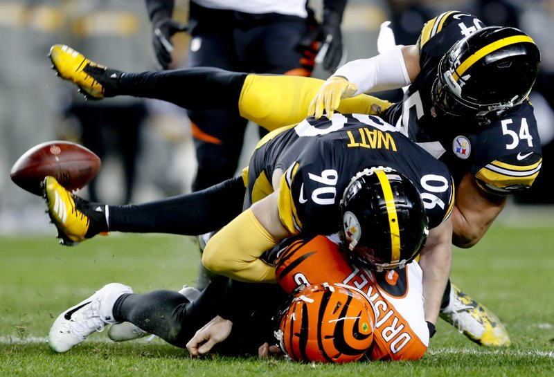 Cincinnati Bengals quarterback Jeff Driskel, bottom, loses the ball as he is hit by Pittsburgh Steelers outside linebacker T. (90) and linebacker L.J. Fort (54) in the second quarter of an NFL football game, Sunday, Dec. 30, 2018, in Pittsburgh. Driskel recovered the fumble. (AP Photo/Don Wright)