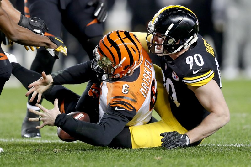 Cincinnati Bengals quarterback Jeff Driskel (6) loses the ball as he is hit by Pittsburgh Steelers outside linebacker T. (90) in the second quarter of an NFL football game, Sunday, Dec. 30, 2018, in Pittsburgh. Driskel recovered the fumble. (AP Photo/Don Wright)