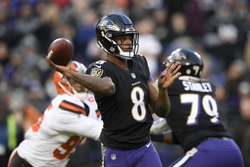 Baltimore Ravens quarterback Lamar Jackson throws a pass in the first half of an NFL football gameagainst the Cleveland Browns, Sunday, Dec. (AP Photo/Nick Wass)