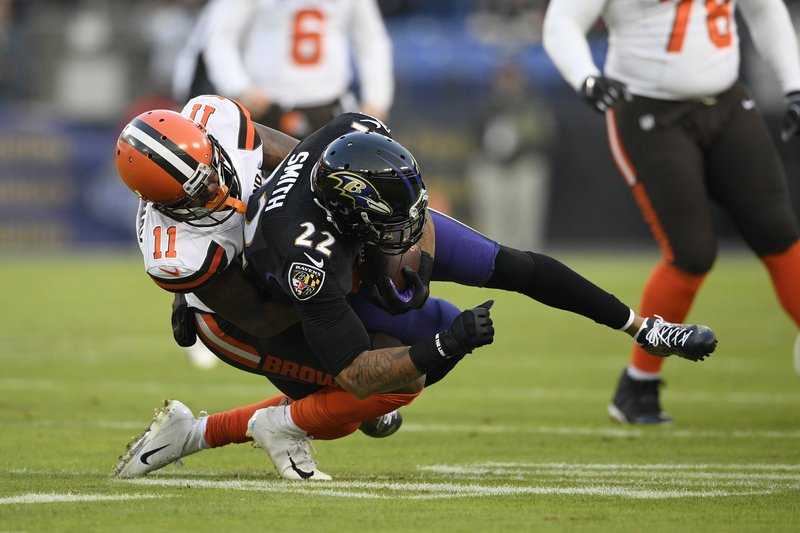 Baltimore Ravens cornerback Jimmy Smith (22) intercepts a pass in front of Cleveland Browns wide receiver Antonio Callaway in the first half of an NFL football game, Sunday, Dec. (AP Photo/Nick Wass)