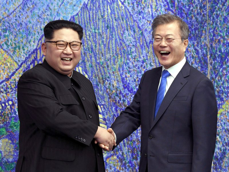 FILE- In this April 27, 2018, file photo, North Korean leader Kim Jong Un, left, poses with South Korean President Moon Jae-in for a photo inside the Peace House at the border village of Panmunjom in Demilitarized Zone, South Korea. (Korea Summit Press Pool via AP. File)