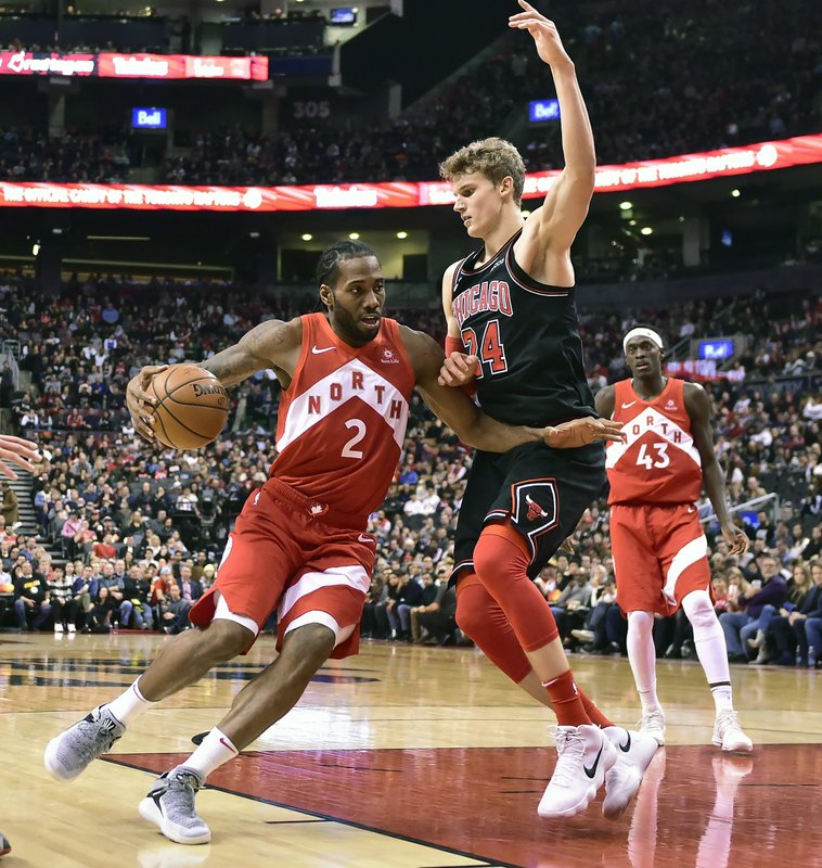 Toronto Raptors forward Kawhi Leonard (2) drives to the net against Chicago Bulls forward Lauri Markkanen (24) during the second half of an NBA basketball game, Sunday, Dec. (Frank Gunn/The Canadian Press via AP)