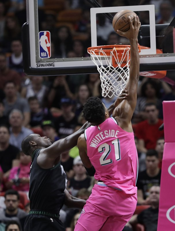 Miami Heat center Hassan Whiteside (21) shoots over Minnesota Timberwolves center Gorgui Dieng during the first half of an NBA basketball game, Sunday, Dec. (AP Photo/Lynne Sladky)
