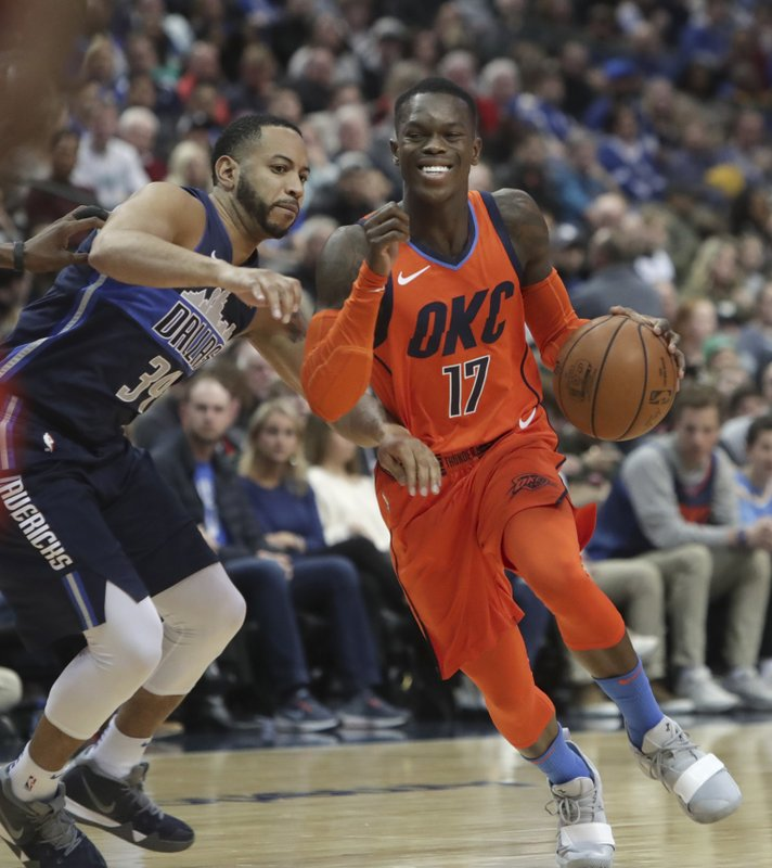 Oklahoma City Thunder guard Dennis Schroder (17), of Germany, drives against Dallas Mavericks guard Devin Harris (34) during the first half of an NBA basketball game in Dallas, Sunday, Dec. (AP Photo/LM Otero)