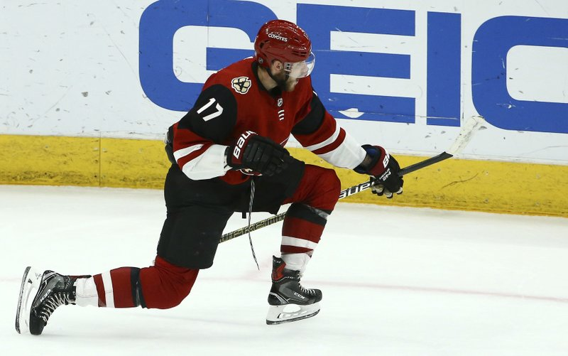 Arizona Coyotes center Alex Galchenyuk celebrates his goal against the Vegas Golden Knights during the second period of an NHL hockey game Sunday, Dec. (AP Photo/Ross D. Franklin)