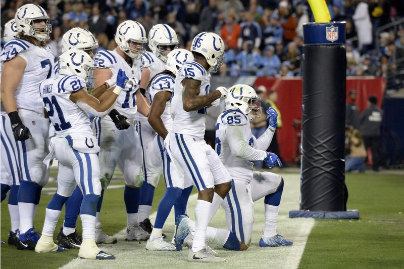 Indianapolis Colts tight end Eric Ebron (85) celebrates after catching a 9-yard touchdown pass against the Tennessee Titans in the first half of an NFL football game Sunday, Dec. (AP Photo/Mark Zaleski)