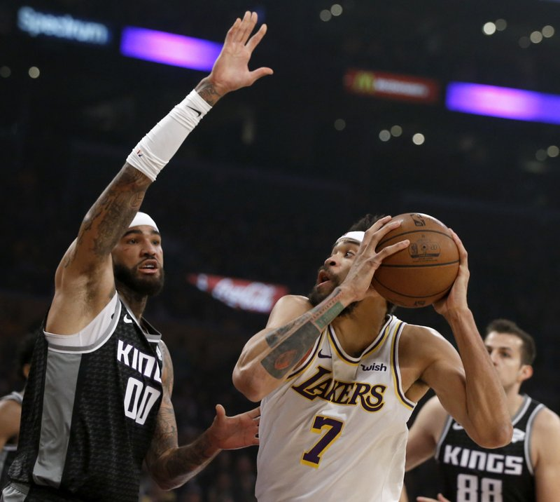 Los Angeles Lakers center JaVale McGee (7) looks to shoot against Sacramento Kings center Willie Cauley-Stein (00) during the first half of an NBA basketball game in Los Angeles, Sunday, Dec. (AP Photo/Alex Gallardo)