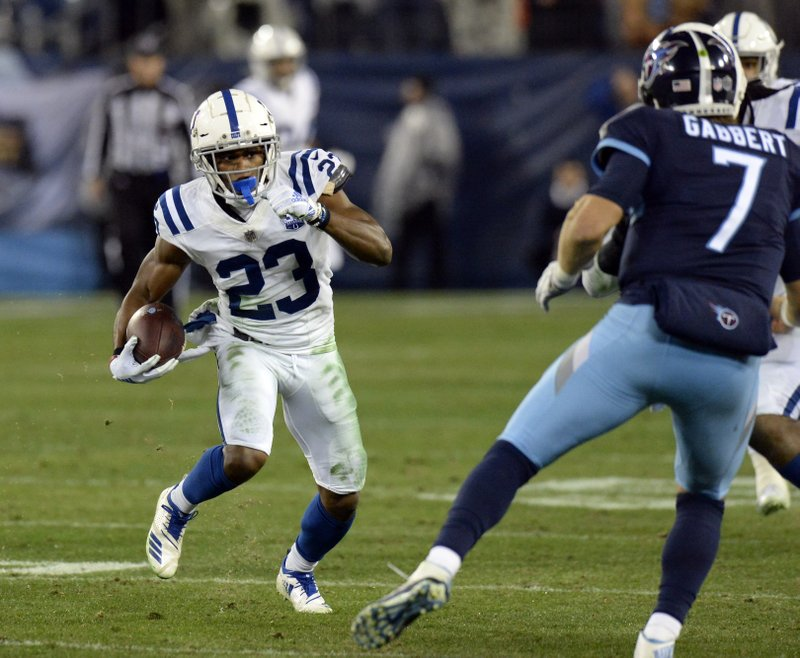 Indianapolis Colts cornerback Kenny Moore (23) runs the ball back after intercepting a pass by Tennessee Titans quarterback Blaine Gabbert (7) in the second half of an NFL football game Sunday, Dec. (AP Photo/Mark Zaleski)