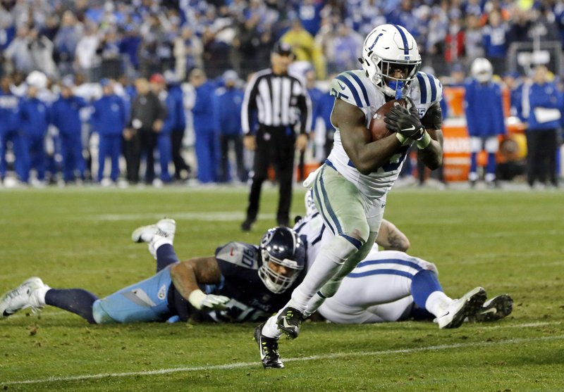 Indianapolis Colts running back Marlon Mack (25) scores a touchdown on an 8-yard run against the Tennessee Titans in the second half of an NFL football game Sunday, Dec. (AP Photo/James Kenney)