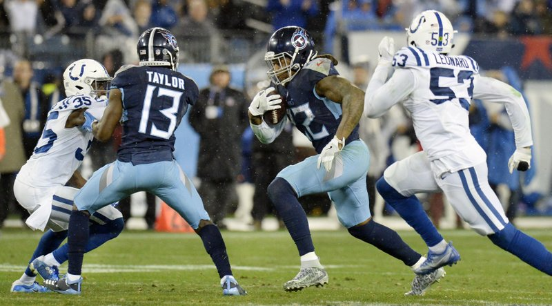 Tennessee Titans running back Derrick Henry (22) carries the ball against Indianapolis Colts defenders Pierre Desir (35) and Darius Leonard (53) in the second half of an NFL football game Sunday, Dec. (AP Photo/Mark Zaleski)