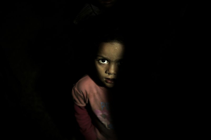 A child stands in a room at a shelter for displaced persons in Ibb, Yemen, in this Aug. 3, 2018, photo. (AP Photo/Nariman El-Mofty)