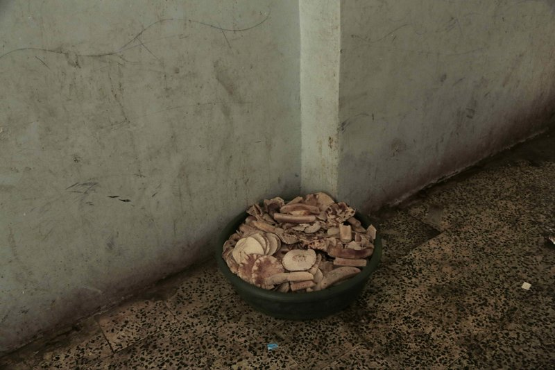 A bucket filled with bread at a shelter for displaced persons in Ibb, Yemen, is shown in this Aug. 3, 2018, photo. (AP Photo/Nariman El-Mofty)