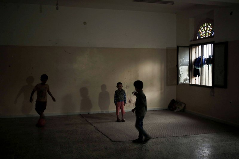 Children play in a room at a shelter for displaced persons in Ibb, Yemen, in this Aug. 3, 2018, photo. (AP Photo/Nariman El-Mofty)