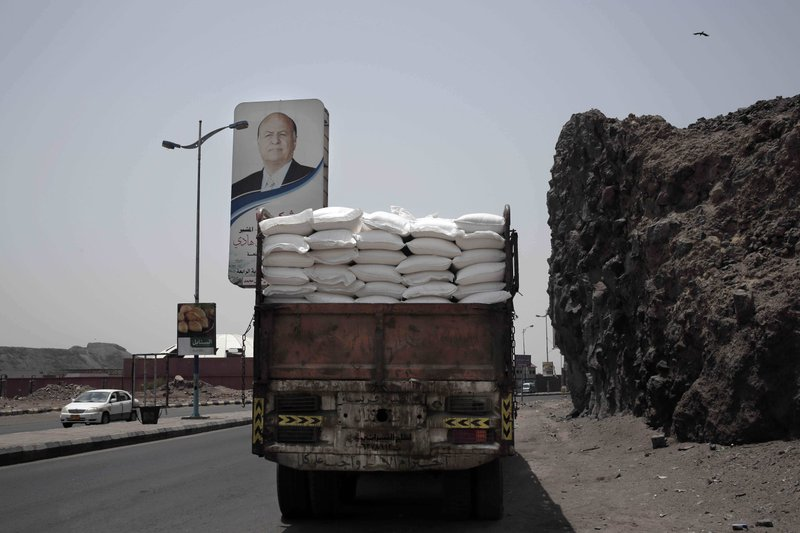 A truck carries aid on a road in Aden, Yemen, in this July 23, 2018, photo. Relief workers in Yemen said armed factions often manipulate lists of those registered to receive food aid to divert it to their own supporters and families. (AP Photo/Nariman El-Mofty)