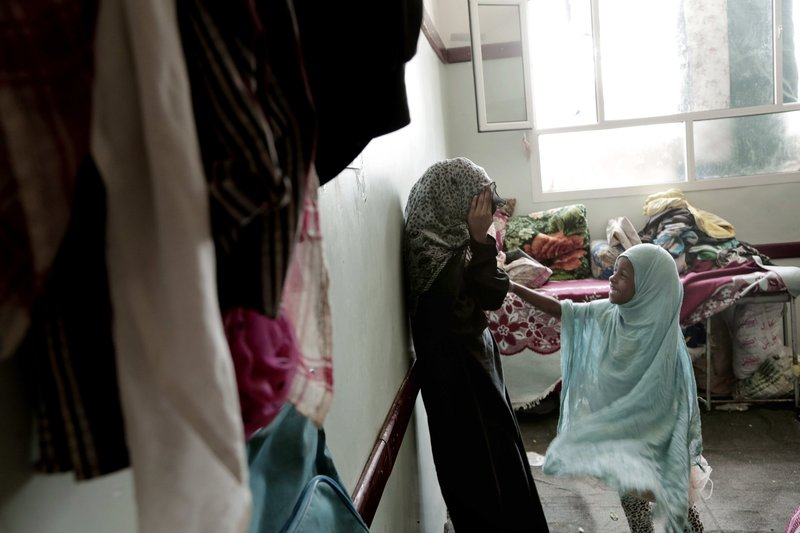 Sisters play in their room at a shelter for displaced persons in Ibb, Yemen in this Aug. 3, 2018, photo. (AP Photo/Nariman El-Mofty)