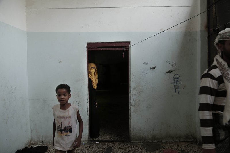 People walk in a shelter for displaced persons in Ibb, Yemen, in this Aug. 3, 2018, photo. Even with food aid that makes it into Yemen, 15. (AP Photo/Nariman El-Mofty)