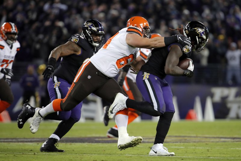 Baltimore Ravens inside linebacker C.J. Mosley, right, rushes past Cleveland Browns center JC Tretter after intercepting a pass attempt in the second half of an NFL football game, Sunday, Dec. (AP Photo/Carolyn Kaster)