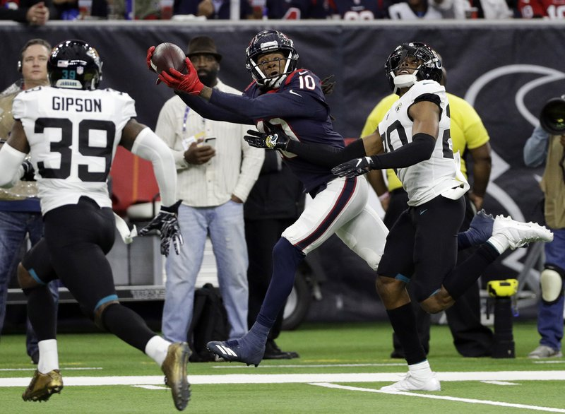 Houston Texans wide receiver DeAndre Hopkins (10) pulls in a pass in front of Jacksonville Jaguars cornerback Jalen Ramsey (20) during the second half of an NFL football game, Sunday, Dec. (AP Photo/David J. Phillip)