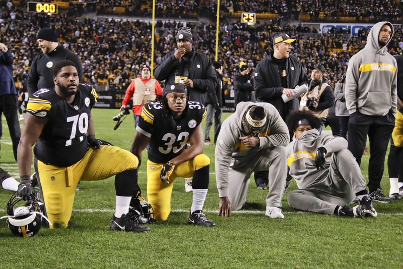 Pittsburgh Steelers nose tackle Javon Hargrave (79) and running back Trey Edmunds (33) watch along with other teammates as the Cleveland Browns play against the Baltimore Ravens as the game is shown on the scoreboard screen after they defeated the Cincinnati Bengals in their NFL football game, Sunday, Dec. (AP Photo/Gene J. Puskar)