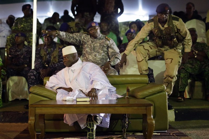 FILE- In this Tuesday, Nov. 29, 2016, file photo, Gambian officers signal to the media not to block the public's view during President Yahya Jammeh's final rally in Banjul, Gambia. (AP Photo/Jerome Delay, File)