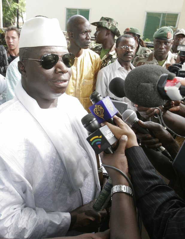 FILE- In this Friday, Sept. 22, 2006 file photo, Former Gambian President Yaya Jammeh speaks to journalists after casting his vote during the presidential election in Banjul, Gambia. (AP Photo/Rebecca Blackwell, File)