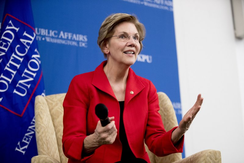 FILE - In this Nov. 29, 2018, file photo, Sen. Elizabeth Warren, D-Mass., answers questions at the American University Washington College of Law in Washington, after delivering a speech on her foreign policy vision for the country. (AP Photo/Andrew Harnik, File)