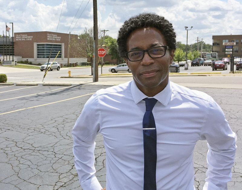 FILE - In this Aug. 8, 2018 file photo, Wesley Bell stands outside the Ferguson, Mo., police headquarters in Ferguson, Ma. (AP Photo/Jim Salter)